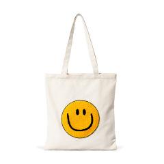 微笑帆布袋 一包收纳轻松出行 拉链开合 独立内袋牢固耐用 搞活动送什么小礼品好